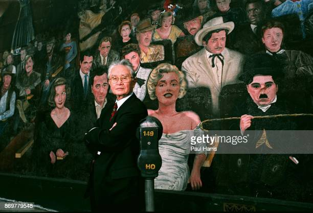 Dr Thomas Noguchi photographed besides a mural of Hollywood stars who are dead off Hollywood Boulevard in his 30 years as LA Coroner he examined the...