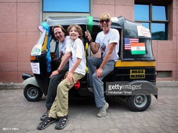 Dr Tim Siladaugh with his kid Rohan and his wife Cat pose for a picture before leaving on road rally along with 6 Indian doctors and 8 American...