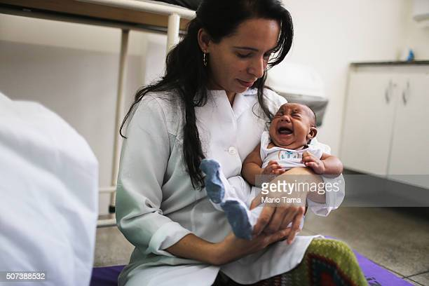 Dr Valeria Barros treats a 6week old baby born with microcephaly at the Lessa de Andrade polyclinic during a physical therapy session on January 29...