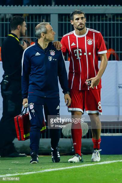 Dr Volker Braun of Bayern Muenchen and Javier Martinez of Bayern Muenchen looks on during the DFL Supercup 2017 match between Borussia Dortmund and...