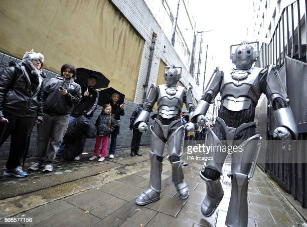 Dr Who fans are visited by two Cybermen as they queue outside HMV in Oxford St for a signing session for the programme's new DVD box set by the stars...