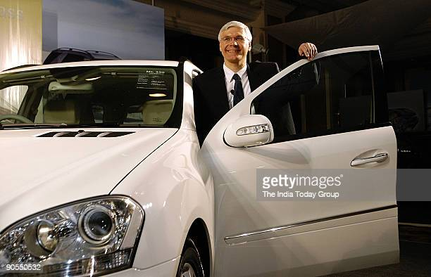 Dr Wilfried G Aulbur CEO and MD Mercedes Benz India poses with Mercedes M Class Car during its Launch on 25 January 2006 in Mumbai India Potrait