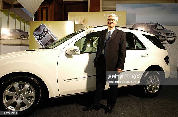 Dr Wilfried G Aulbur CEO and MD Mercedes Benz India poses with Mercedes M Class Car during its Launch on 25 January 2006 in Mumbai India Profile