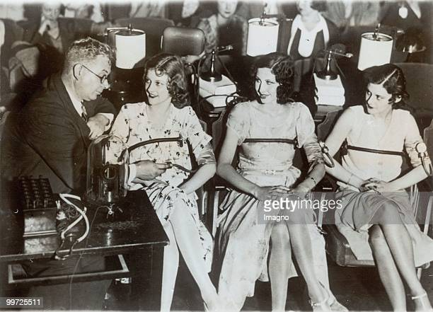 Dr William Marston making an unusal test on threee pretty girls one beeing a blonde a brunette and a redhaired girl to find out which made the...