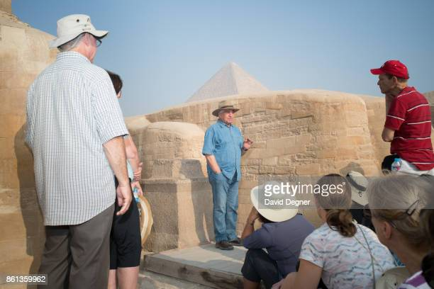 Dr Zahi Hawass is an Egyptian archaeologist an Egyptologist and former Minister of State for Antiquities Affairs gives a private tour to a tour group...