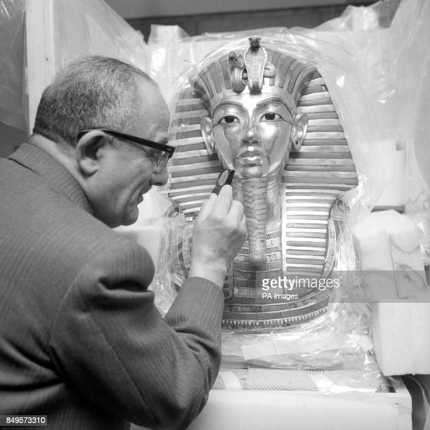 Dr Zakai Iskander a DirectorGeneral of the Department of Antiquities at the Cairo Museum at British Museum in London He is examining a solid gold...