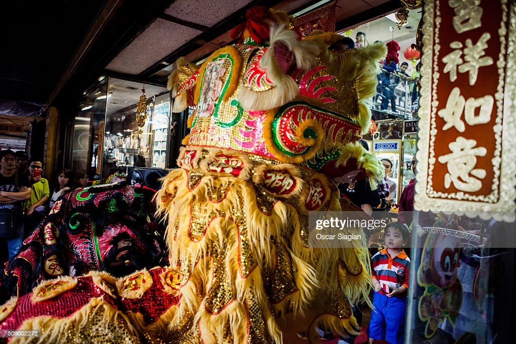 Dracgon dancer play in front of a shop for giving bless to the shop at Glodok district on February 8, 2016 in Jakarta, Indonesia. The Chinese Lunar New Year also known as the Spring Festival, which is based on the Lunisolar Chinese calendar, is celebrated from the first day of the first month of the lunar year and ends with Lantern Festival on the fifteenth day.