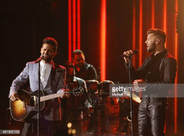 Draco Rosa and Ricky Martin perform onstage during the 14th Annual Latin GRAMMY Awards held at Mandalay Bay Resort and Casino on November 21 2013 in...
