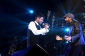 Draco Rosa performs with Juan Luis Guerra at Draco Friends Concert at Coliseo de Puerto Rico on December 6 2013 in San Juan Puerto Rico
