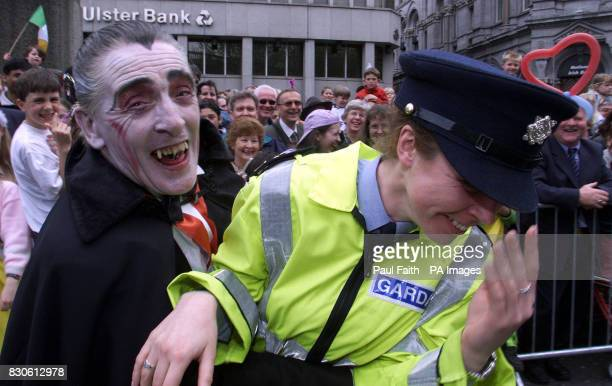 A Dracula look alike has a laugh with a Female Garda officer as the parade makes it's way through the streets of Dublin to celebrate St Patricks day...