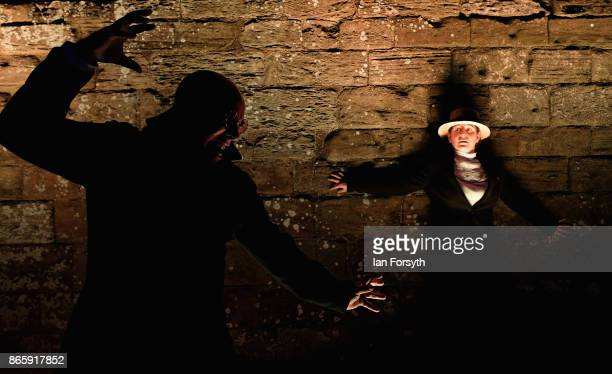 Dracula stalks his victim in a performance during a spectacular light display illuminating the ruins of the historic Whitby Abbey on October 24 2017...