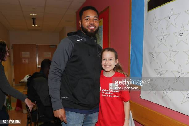 Draft invitee Ohio State corner back Marshon Lattimore take a photo with Colleen at Shriners Hospital for Children on April 26 2017 at the NFL Play...