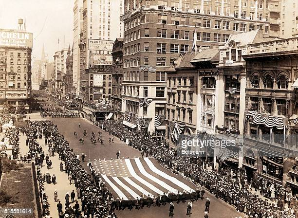 A draft parade heads up Fifth Avenue near 41st Street The lions of the New York Public Library are on the far left and the spire of St Patrick's can...