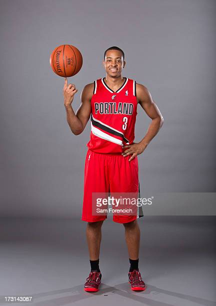 NBA draft pick CJ McCollum of the Portland Trail Blazers poses for photos during a photo shoot July 8 2013 at the Rose Garden Arena in Portland...