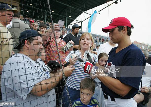 NHL draft prospect Alexander Ovechkin signs autographs for fans prior to the start of the USA vs Canada baseball game at the Durham Bulls Park during...