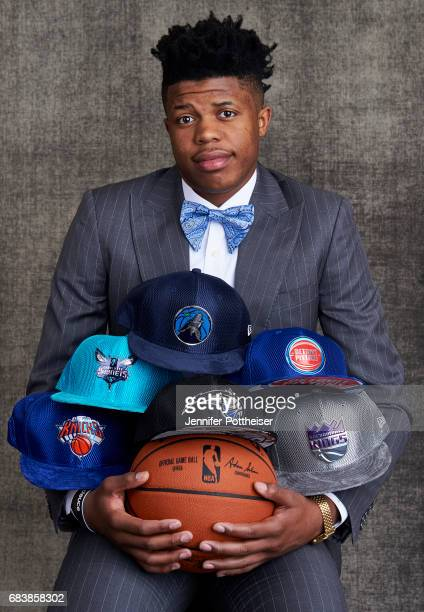 Draft prospect Justin Patton poses poses with draft caps for portraits prior to the 2017 NBA Draft Lottery at the NBA Headquarters in New York New...