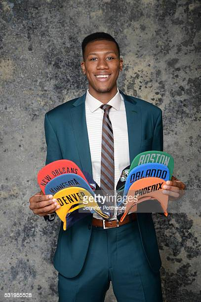 Draft Prospect Kris Dunn poses for some portraits with some draft hats prior to the 2016 NBA Draft Lottery on May 17 2016 at the NBA Headquarters in...