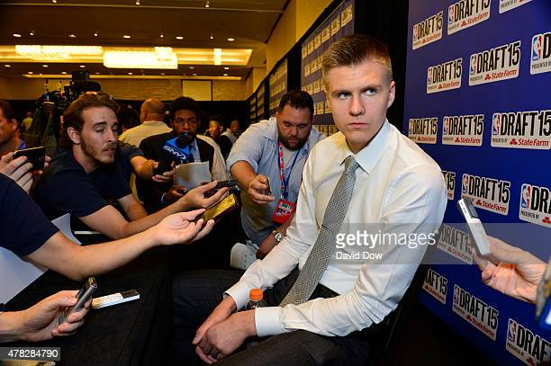 Draft Prospect Kristaps Porzingis speaks to the media during media availability as part of the 2015 NBA Draft on June 24 2015 at the Westin Times...