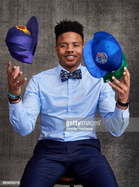 Draft prospect Markelle Fultz poses poses with draft caps for portraits prior to the 2017 NBA Draft Lottery at the NBA Headquarters in New York New...