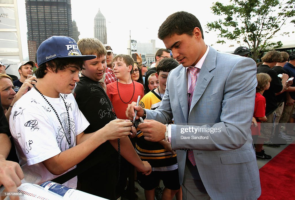 NHL draft prospect Nail Yakupov signs autographs on the red carpet before Round One of the 2012 NHL Entry Draft at Consol Energy Center on June 22, 2012 in Pittsburgh, Pennsylvania. Yakupov was drafted first overall by the Edmonton Oilers.