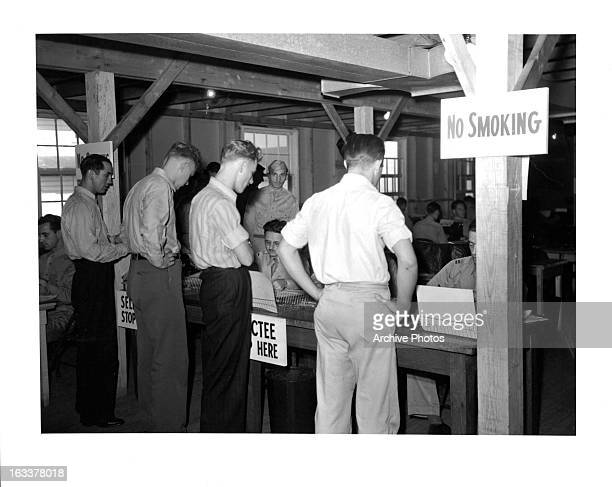 Draftees reporting for examination at Governor's Island Army Induction Center 9/18/1941