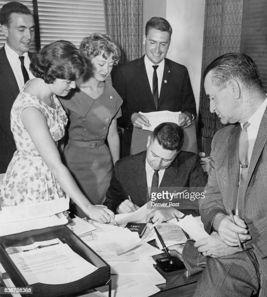 DraftRockefeller Recruits a Backer A M Alloway signs a draftRockefeller petition in DenverUS National Bank Tower office as H O Lynch waits his turn...
