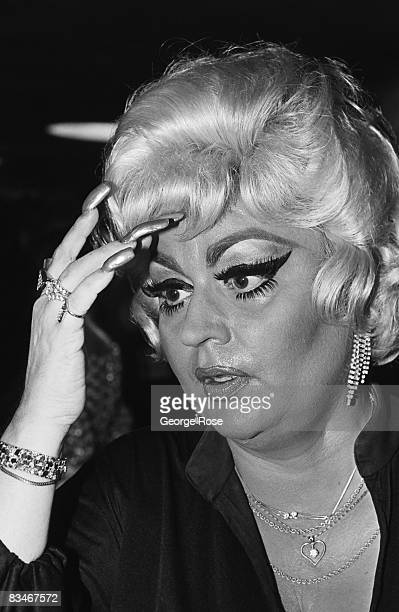 Drag queen and star of several John Waters movies Divine poses for photographers in this 1980 West Los Angeles California photo taken at movie...