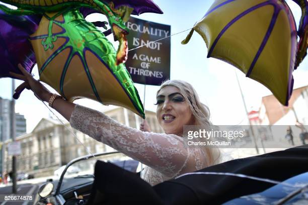 A drag queen dressed as the character Daenerys from the television series Game of Thrones takes part in the Belfast Gay Pride parade on August 5 2017...