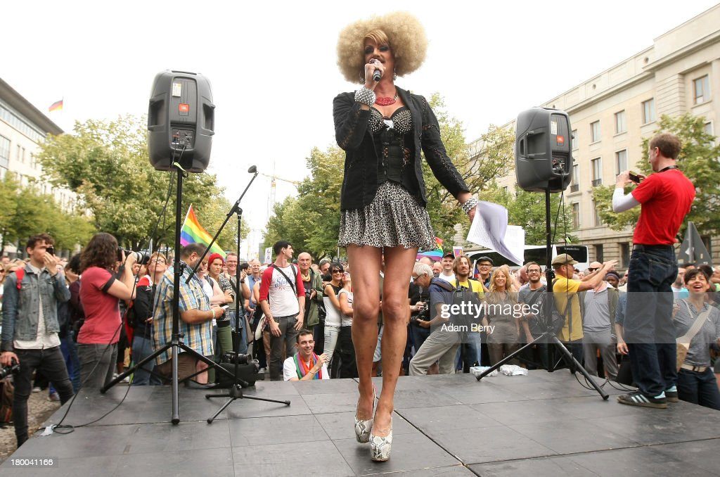 Drag queen Gloria Viagra speaks in front of the Russian Embassy as part of the 'To Russia With Love' Global Kiss-In on September 8, 2013 in Berlin, Germany. The event was designed to show international solidarity with homosexuals in Russia, currently under pressure from with what is considered by some in societies with more liberal gay rights policies to be homophobic legislation.