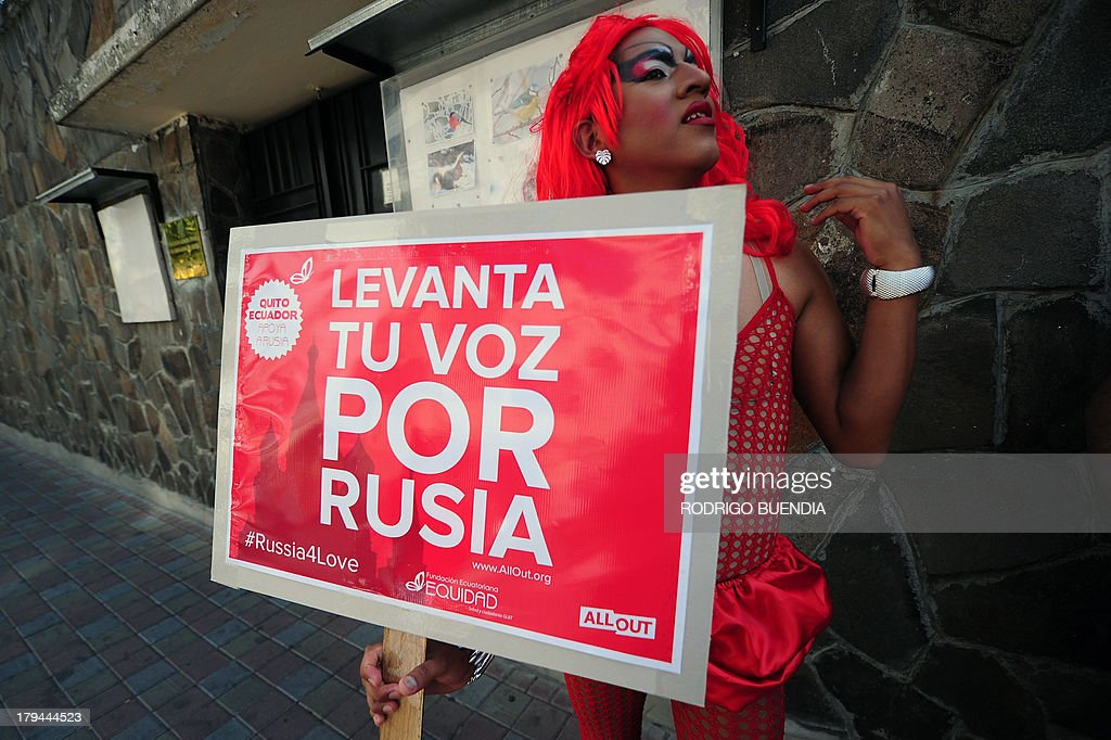 A drag queen holds a sign during a protest against homophobia and repression against gays in Russia, in front of the Russian embassy in Quito, on Spetember 3, 2013. Gay rights activists rallied as part of an international protest against hotly disputed Russian laws cracking down on homosexual behaviour.