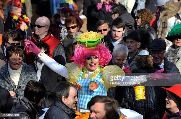 A Drag Queen in a pasta dress attends the traditional 'Tanz der Marktweiber' on carnival Tuesday March 8 2011 at the Viktualienmarkt market place in...