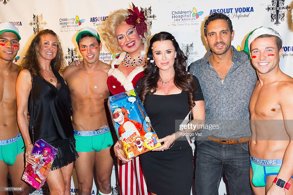 Drag queen Momma (Worthie Meacham), TV personality Kyle Richards and her husband Mauricio Umansky attend The Abbey's 8th annual Christmas In September Event benefiting The Children's Hospital Los Angeles at The Abbey on September 24, 2013 in West Hollywood, California.