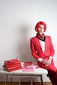 Drag queen posing on a desk