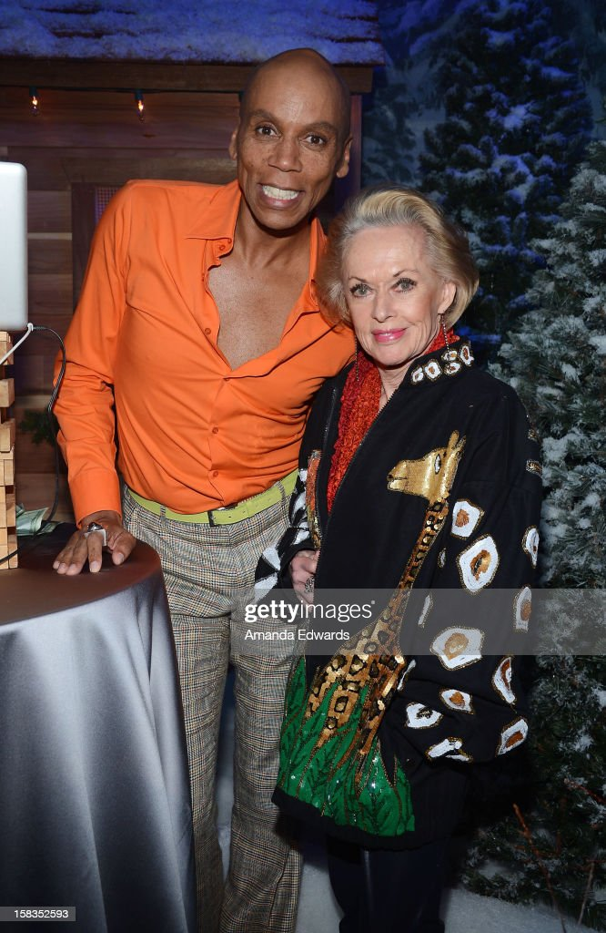 Drag queen RuPaul (L) and actress Tippi Hedren attend the World Of Wonder book release party/birthday bash at The Globe Theatre at Universal Studios on December 13, 2012 in Universal City, California.
