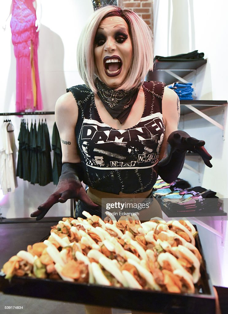 Drag queen Sharon Needles enjoys appetizers during the opening of