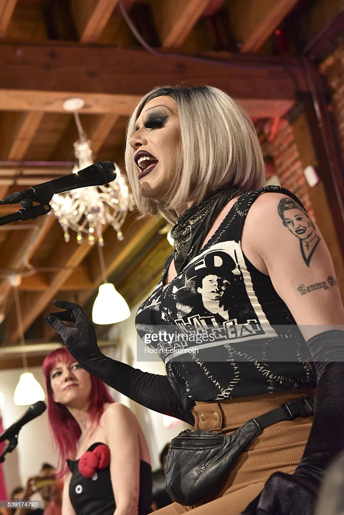 Drag queen Sharon Needles performs during the opening of