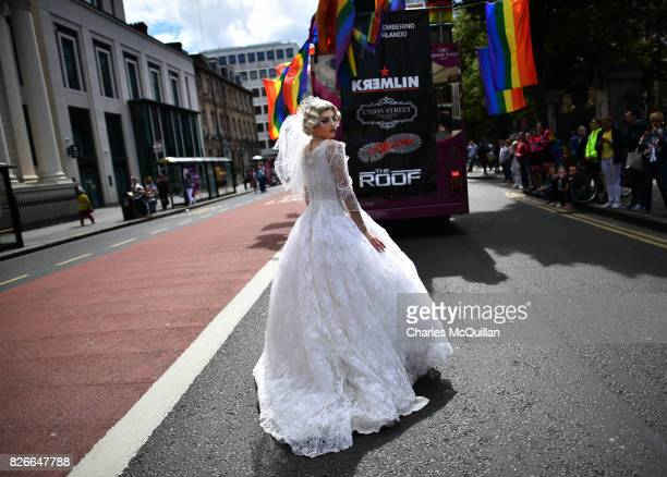 A drag queen wearing a wedding dress takes part in Belfast Gay Pride on August 5 2017 in Belfast Northern Ireland The province is the only part of...