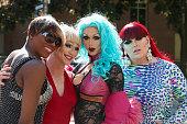 Drag queens posing on city street