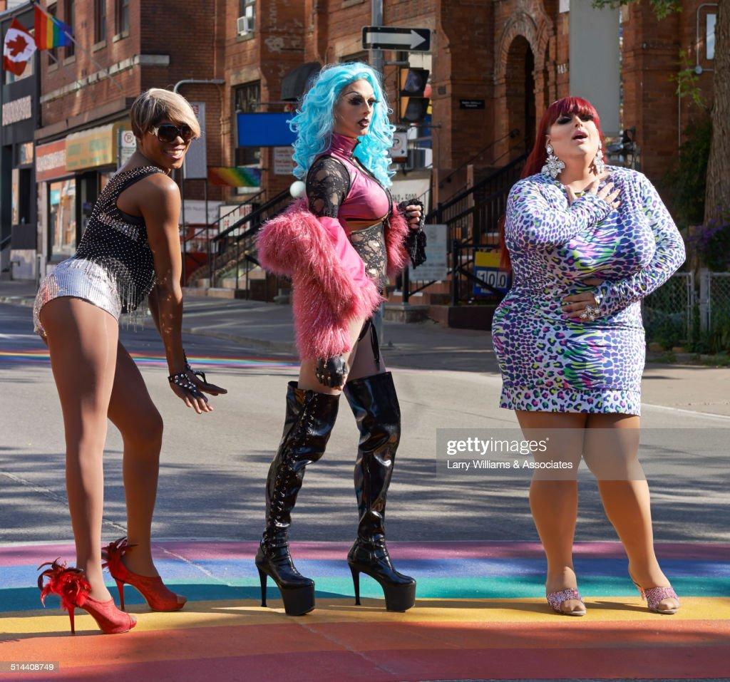 Drag queens posing on rainbow pavement on city street, Toronto, Ontario, Canada