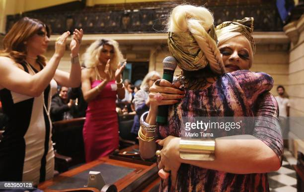 Drag queens Sara and Nina hug after performing during an LGBT protest held inside city council on May 16 2017 in Rio de Janeiro Brazil Protestors...