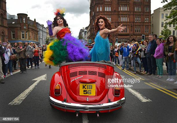 Drag queens wave to the crowds as thousands of participants and supporters take part in the 25th annual Belfast Pride parade on August 1 2015 in...