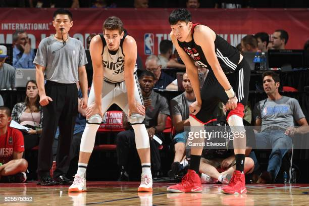 Dragan Bender of the Phoenix Suns and Zhou Qi of the Houston Rockets look downcourt on July 10 2017 at the Thomas Mack Center in Las Vegas Nevada...