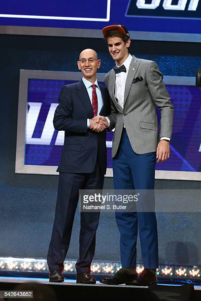 Dragan Bender shakes hands with NBA Commissioner Adam Silver after being selected number four overall by the Phoenix Suns during the 2016 NBA Draft...