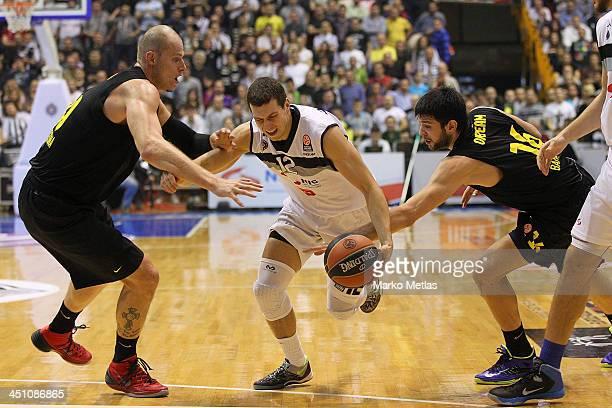 Dragan Milosavljevic of Partizan mts Belgrade competes with Maciej Lampe #30 of FC Barcelona and Kostas Papanikolau #16 of FC Barcelona during the...