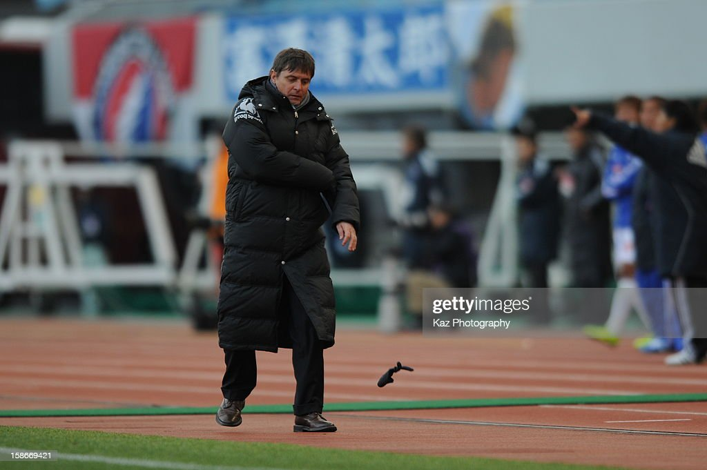 <a gi-track='captionPersonalityLinkClicked' href=/galleries/search?phrase=Dragan+Stojkovic&family=editorial&specificpeople=625216 ng-click='$event.stopPropagation()'>Dragan Stojkovic</a>, coach of Nagoya Grampus throws his glove in anger during the 92nd Emperor's Cup Quarter Final match between Nagoya Grampus and Yokohama F.Marinos at Mizuho Stadium on December 23, 2012 in Nagoya, Japan.