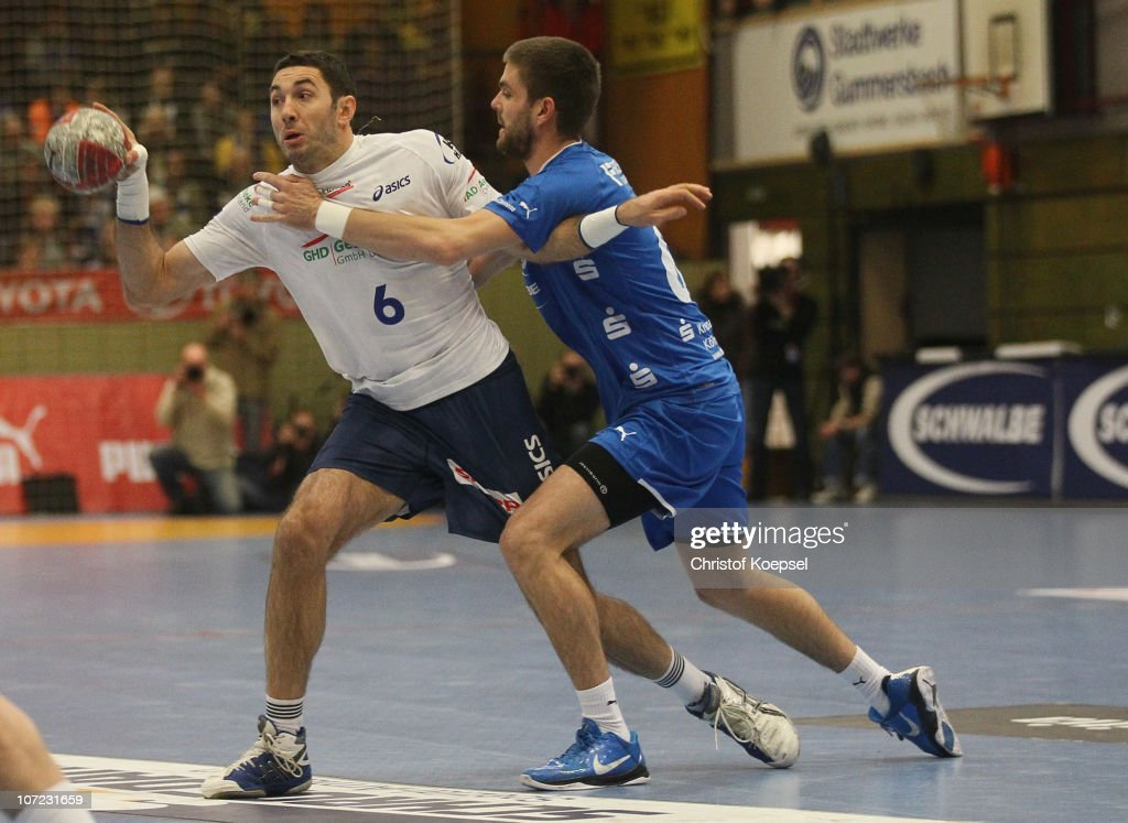 Drago Vukovic of Gummersbach (R) challenges <a gi-track='captionPersonalityLinkClicked' href=/galleries/search?phrase=Blazenko+Lackovic&family=editorial&specificpeople=663011 ng-click='$event.stopPropagation()'>Blazenko Lackovic</a> of Hamburg (L) during the Bundesliga match between VfL Gummersbach and HSV Hamburg at the Eugen-Haas-Sporthalle on December 1, 2010 in Gummersbach, Germany.