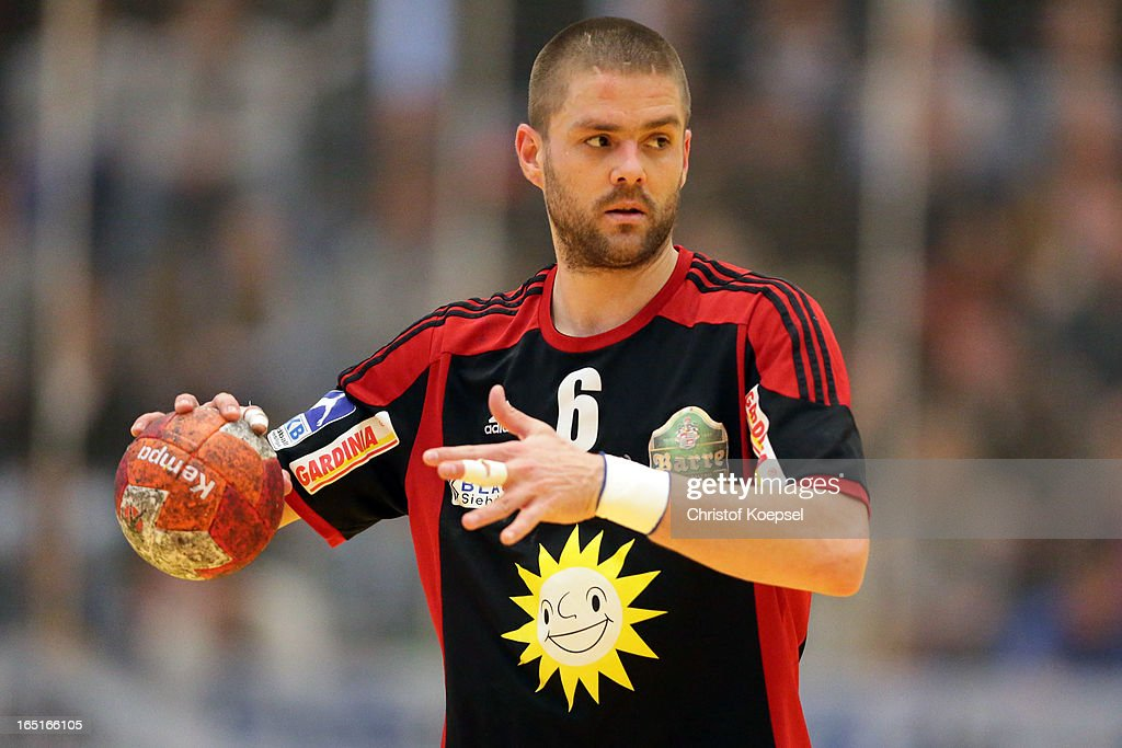 Drago Vukovic of Tus N-Luebbecke passes the ball during the DKB Handball Bundesliga match between TUSEM Essen and Tus N-Luebbecke at the Sportpark Am Hallo on March 31, 2013 in Essen, Germany.