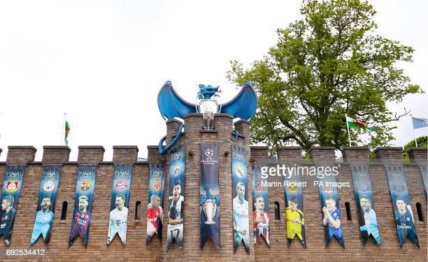 A dragon and the UEFA Champions League trophy on the walls of Cardiff Castle