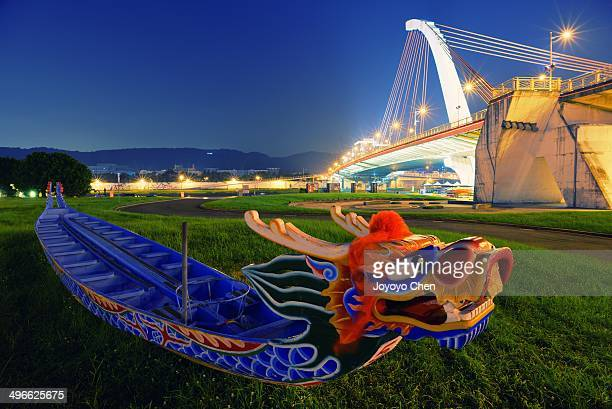 Dragon boat and bridge in blue hour