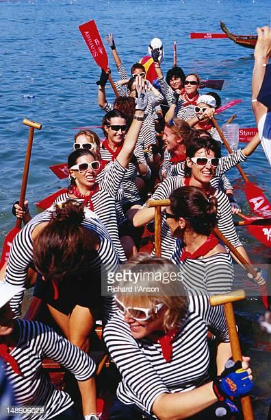Dragon boat crew preparing to race at Stanley Beach.
